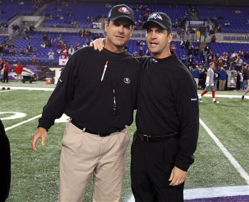 San Francisco 49ers head coach Jim Harbaugh and Baltimore Ravens head coach John Harbaugh prior to an NFL football game at M&T Bank Stadium in Baltimore, Thursday, Nov. 24, 2011. The Harbaughs became the first brothers to face each other as NFL head coaches. (AP Photo/Ben Liebenberg)
